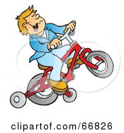 Boy Riding A Red Bike With Training Wheels