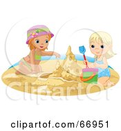 Two Sisters Building A Sand Castle On A Beach