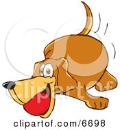 Brown Dog Mascot Cartoon Character Playing With A Red Ball