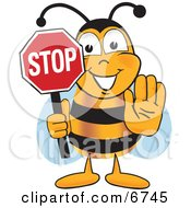 Bee Mascot Cartoon Character Holding His Hand Out And A Red Stop Sign