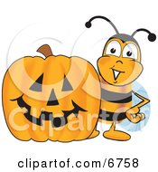 Bee Mascot Cartoon Character With A Carved Halloween Pumpkin