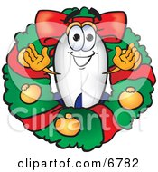 Blimp Mascot Cartoon Character In The Center Of A Christmas Wreath