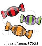 Royalty Free RF Clipart Illustration Of Three Hard Candies In Colorful Striped Wrappers