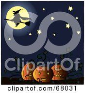 Silhouetted Witch In Front Of A Full Moon Above A Pumpkin Patch