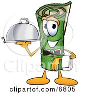 Green Carpet Mascot Cartoon Character Dressed As A Waiter And Holding A Platter