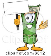 Green Carpet Mascot Cartoon Character Holding A Blank Sign