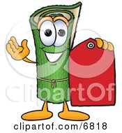 Clipart Picture Of A Green Carpet Mascot Cartoon Character Holding A Red Price Tag