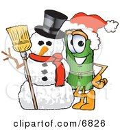 Clipart Picture Of A Green Carpet Mascot Cartoon Character With A Snowman On Christmas