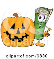 Clipart Picture Of A Green Carpet Mascot Cartoon Character With A Carved Halloween Pumpkin