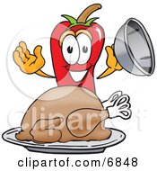Clipart Picture Of A Chili Pepper Mascot Cartoon Character With A Turkey In A Platter by Toons4Biz