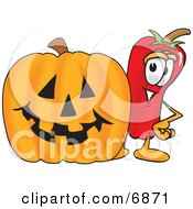 Chili Pepper Mascot Cartoon Character Standing With A Carved Halloween Pumpkin