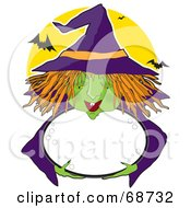 Green Witch With Orange Hair Holding A Bubbly Cauldron Against A Full Moon With Bats