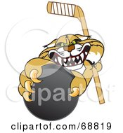 Royalty Free RF Clipart Illustration Of A Bobcat Character Grabbing A Hockey Puck by Toons4Biz