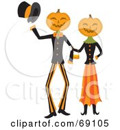 Pumpkin Head Couple Walking Arm In Arm