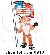 Clipart Picture Of A Fox Mascot Cartoon Character Holding An American Flag by Toons4Biz