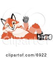 Fox Mascot Cartoon Character Lying On His Back And Waving