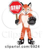 Fox Mascot Cartoon Character Holding A Stop Sign