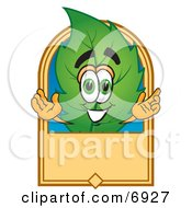 Clipart Picture Of A Leaf Mascot Cartoon Character With A Blank Tan Label