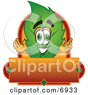 Clipart Picture Of A Leaf Mascot Cartoon Character With A Red And Orange Label by Toons4Biz