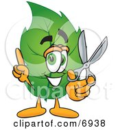 Leaf Mascot Cartoon Character Holding A Pair Of Scissors