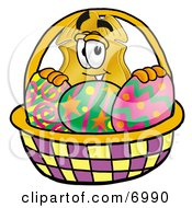 Clipart Picture Of A Badge Mascot Cartoon Character In An Easter Basket Full Of Decorated Easter Eggs