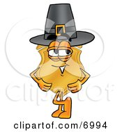 Clipart Picture Of A Badge Mascot Cartoon Character Wearing A Pilgrim Hat On Thanksgiving by Toons4Biz