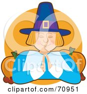 Royalty Free RF Clipart Illustration Of A Praying Pilgrim With Pumpkins Over An Orange Circle by Maria Bell