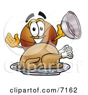 Clipart Picture Of A Basketball Mascot Cartoon Character Serving A Thanksgiving Turkey On A Platter by Toons4Biz