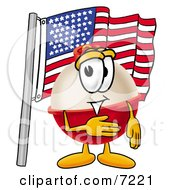 Clipart Picture Of A Fishing Bobber Mascot Cartoon Character Pledging Allegiance To An American Flag by Toons4Biz