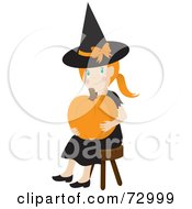 Happy White Girl In A With Costume Sitting And Holding A Halloween Pumpkin