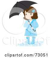 Cute Little Girl Wearing A Rain Coat And Rubber Boots And Standing Under An Umbrella