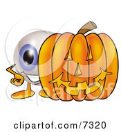 Eyeball Mascot Cartoon Character With A Carved Halloween Pumpkin