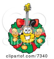 Clipart Picture Of A Guitar Mascot Cartoon Character In The Center Of A Christmas Wreath
