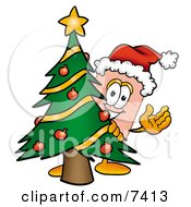 Clipart Picture Of A Bandaid Bandage Mascot Cartoon Character Waving And Standing By A Decorated Christmas Tree by Toons4Biz