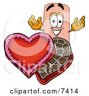 Clipart Picture Of A Bandaid Bandage Mascot Cartoon Character With An Open Box Of Valentines Day Chocolate Candies