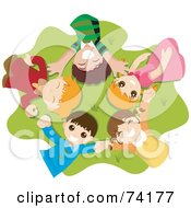 Group Of Happy Children Laying In A Circle On Grass