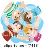 Group Of Four Happy Children Huddling In A Circle And Looking Down