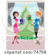 Two Women Laughing And Exchanging Christmas Presents In Front Of A Tree