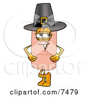 Clipart Picture Of A Bandaid Bandage Mascot Cartoon Character Wearing A Pilgrim Hat On Thanksgiving by Toons4Biz