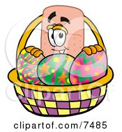 Bandaid Bandage Mascot Cartoon Character In An Easter Basket Full Of Decorated Easter Eggs