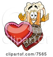 Clipart Picture Of A Beer Mug Mascot Cartoon Character With An Open Box Of Valentines Day Chocolate Candies