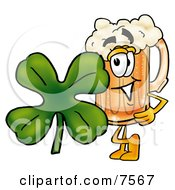 Clipart Picture Of A Beer Mug Mascot Cartoon Character With A Green Four Leaf Clover On St Paddys Or St Patricks Day