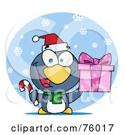 Giving Christmas Penguin Holding A Present And Candy Cane In The Snow
