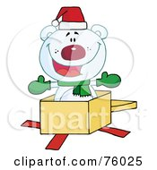 Royalty-Free (RF) Clipart Illustration of a Christmas Polar Bear Popping Out Of A Gift Box by Hit Toon