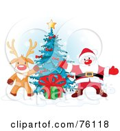 Royalty Free RF Clipart Illustration Of Rudolph The Red Nosed Reindeer And Santa Presenting A Gift In Front Of A Christmas Tree by Pushkin