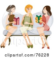 Two Ladies Sitting On A Couch With Their Pregnant Friend Giving Her Presents At Her Baby Shower