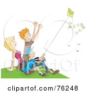 Mom Dad And Boy Flying A Kite On A Hill