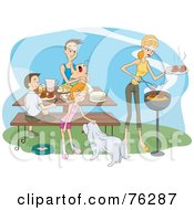 Happy Family With Their Dog Eating A Bbq Picnic