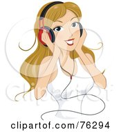 Young Blond Woman Listening To Music Through Headphones