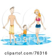 Mom Dad And Son Splashing In Water At A Beach